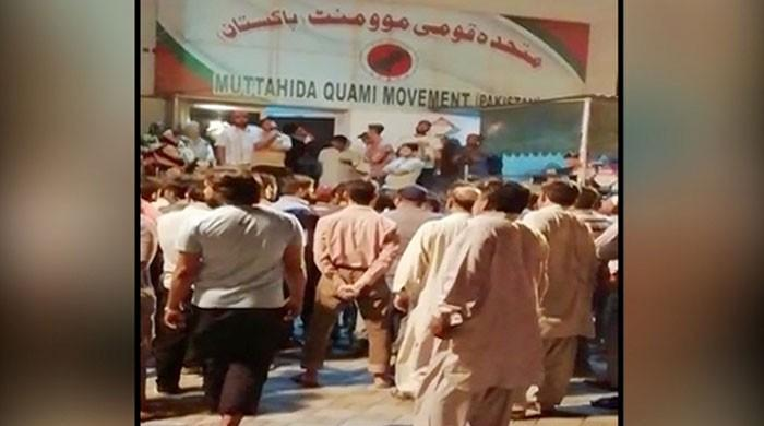 Residents protest outside MQM's Bahadurabad office after eviction notice