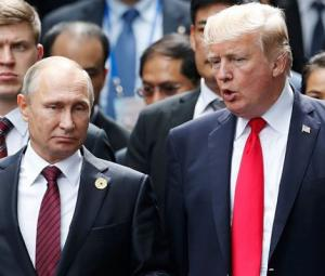 At summit, Trump refuses to confront Putin on vote row