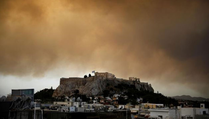 Greek wildfire kills at least 24 near Athens, residents flee