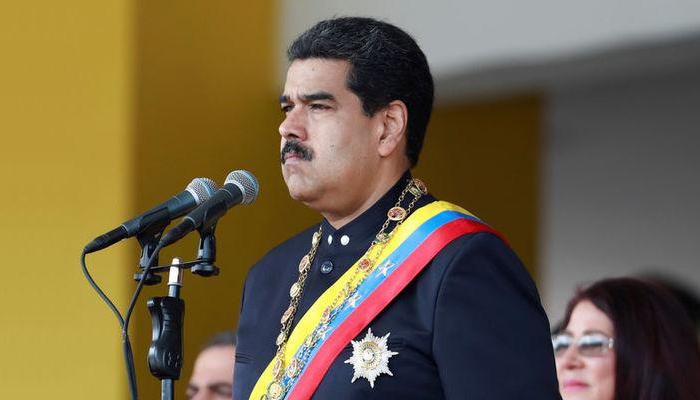 Venezuela's Nicolas Maduro's speech cut off, soldiers seen running