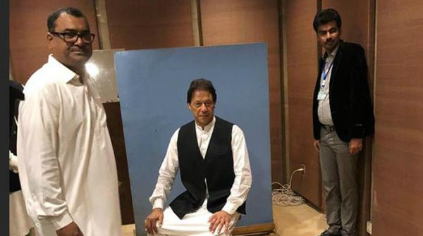 Imran Khan borrows a waistcoat before having his MNA picture taken