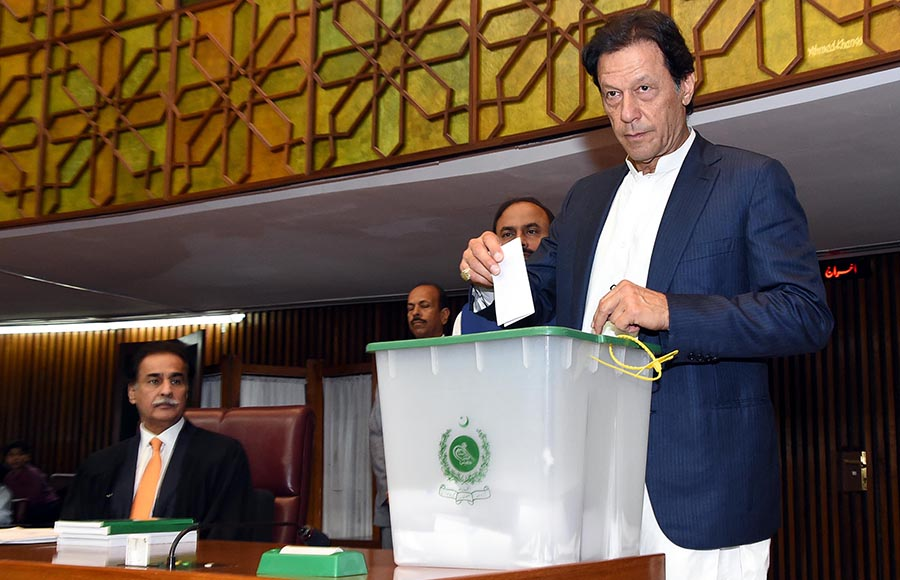 PTI chief MNA Imran Khan casting his vote during polling for Speaker National Assembly at Parliament House - Photo: Online