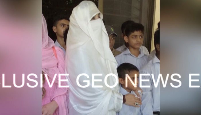 First lady Bushra Bibi stands with children at the orphanage in Lahore. Photo: Geo News