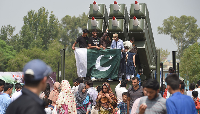 People gather during celebrations to mark the country's Defence Day at the Nur Khan airbase in Rawalpindi on September 6, 2018 - AFP