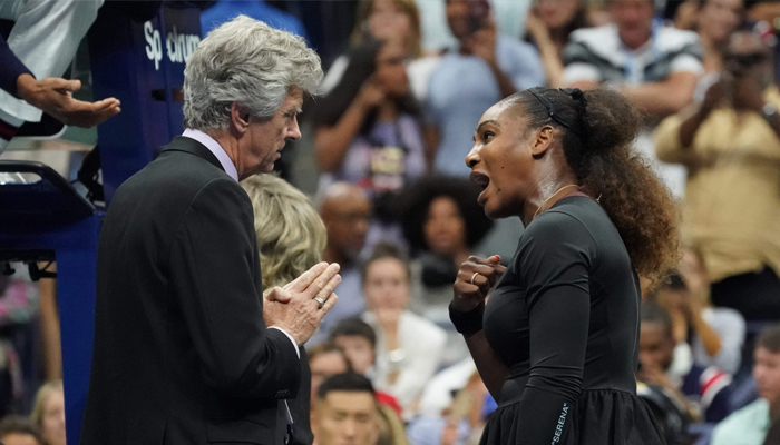 Serena Williams of the US argues with referee Brian Earley after her defeat in the Women's Singles finals match against Naomi Osaka of Japan in the 2018 US Open at the USTA Billie Jean King National Tennis Center, New York City, US, September 8, 2018. AFP/Elsa
