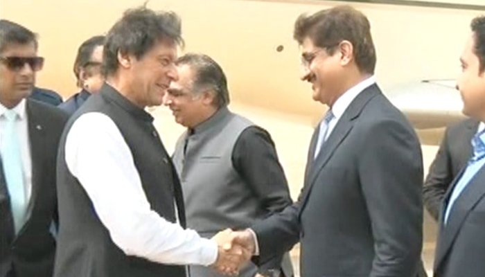 Chief Minister of Sindh Syed Murad Ali Shah and Governor Sindh Imran Ismael receive Prime Minister Imran Khan at the Jinnah International Airport in Karachi on Sunday, September 16, 2018. Photo: Geo News screen grab