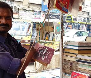 Disabled yet differently abled: Karachi bookseller with no hands makes an honest living