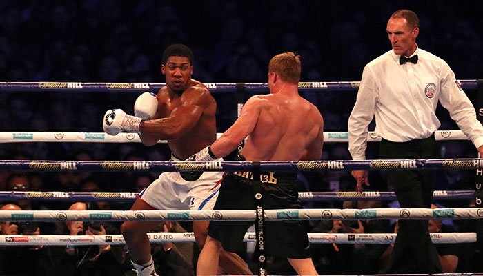 Joshua retains world heavyweight titles with Povetkin stoppage