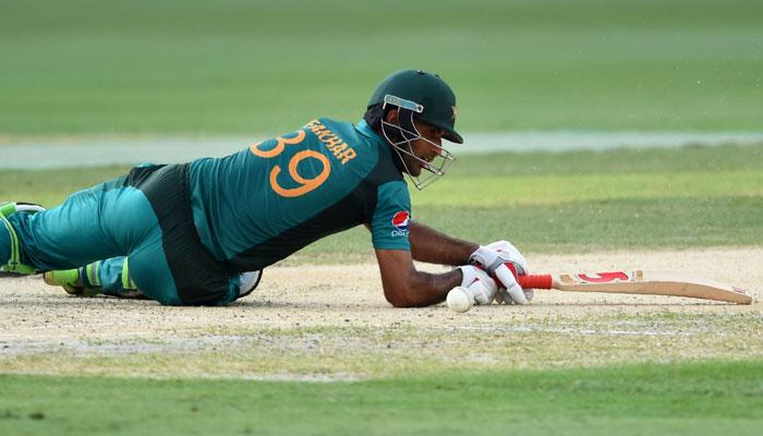 Opener Fakhar Zaman lost his balance on the ball of Kuldeep Yadav. Photo: AFP