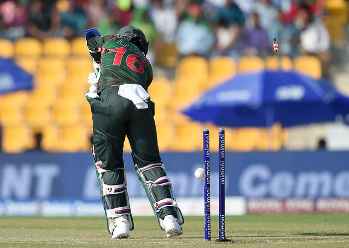 Bangladesh batsman Liton Das is dismissed by Pakistan cricketer Junaid Khan during the one day international (ODI) Asia Cup cricket match between Bangladesh and Pakistan at the Sheikh Zayed Stadium in Abu Dhabi on September 26, 2018 - AFP