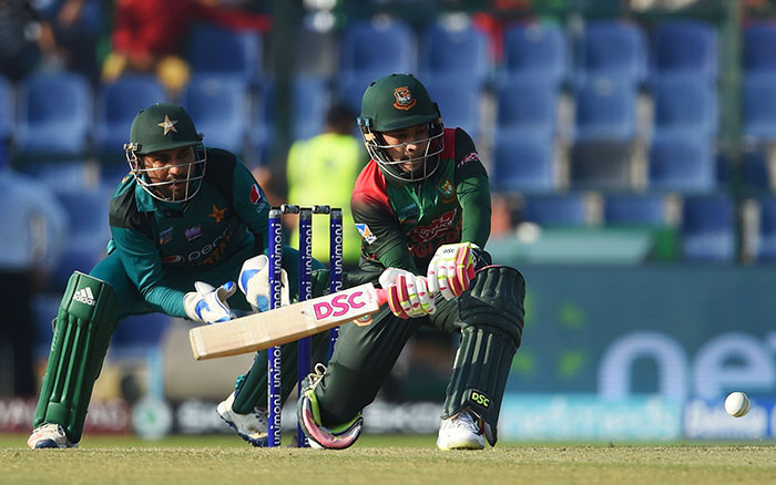 Bangladesh batsman Mushfiqur Rahim plays a shot as Pakistan captain Sarfraz Ahmed (L) looks on during the one day international (ODI) Asia Cup cricket match between Bangladesh and Pakistan at the Sheikh Zayed Stadium in Abu Dhabi on September 26, 2018 - AFP