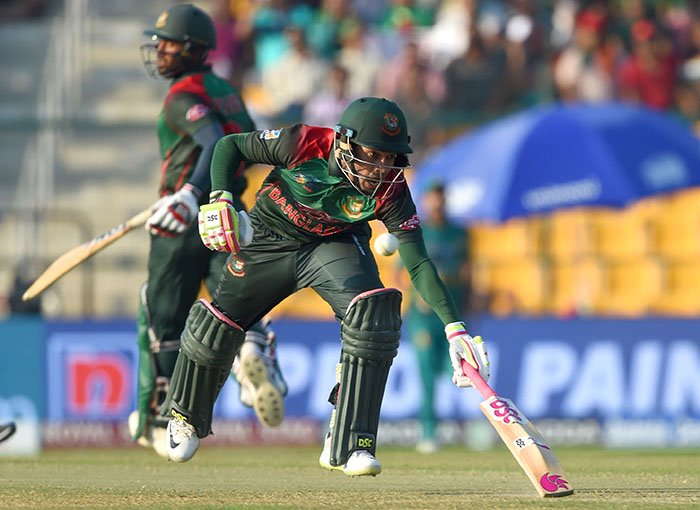 Bangladesh batsman Mushfiqur Rahim (R) and Mohammad Mithun run between the wickets during the one day international (ODI) Asia Cup cricket match between Bangladesh and Pakistan at the Sheikh Zayed Stadium in Abu Dhabi on September 26, 2018 - AFp