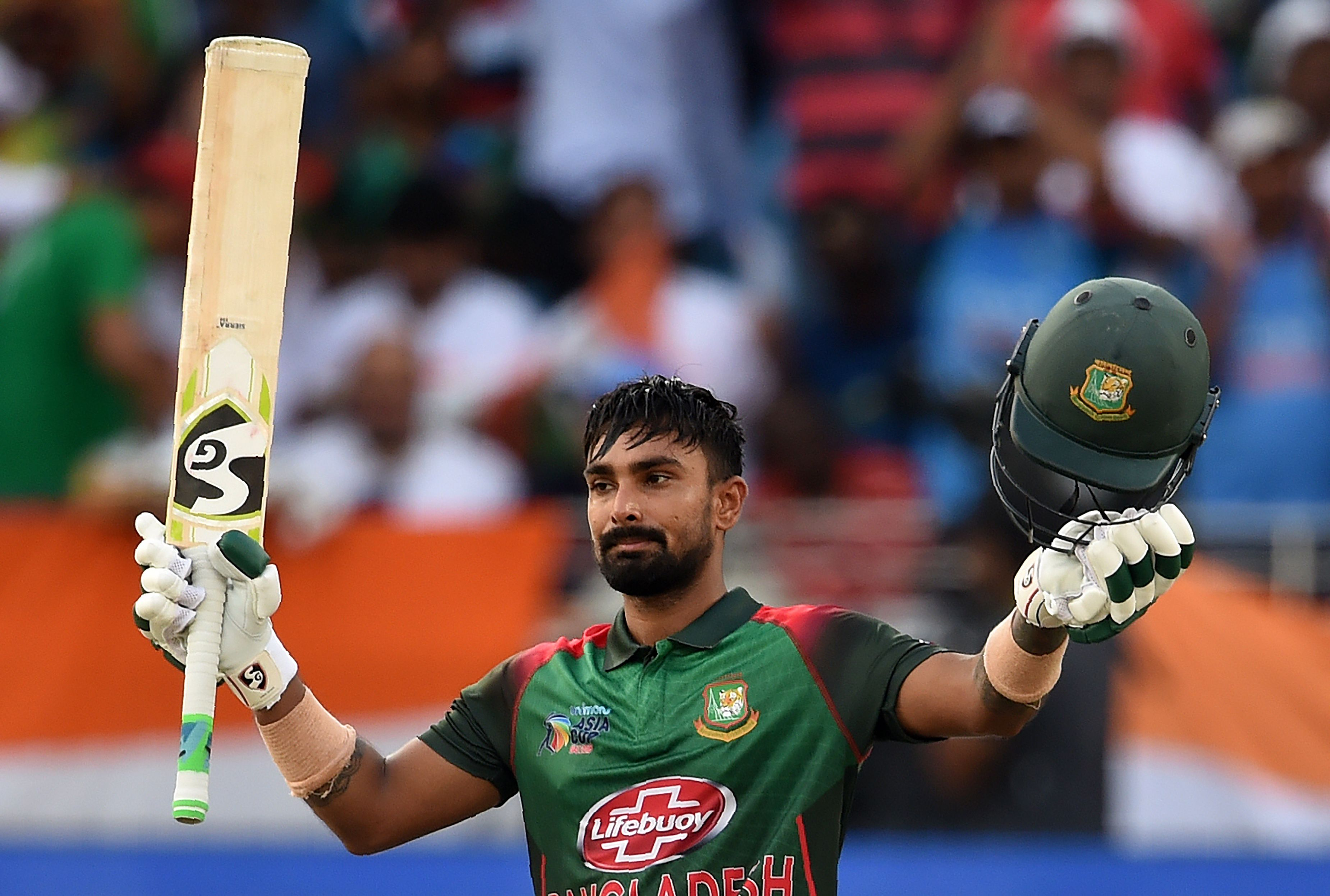 Bangladesh batsman Liton Das celebrates after scoring a century (100 runs) during the final one day international (ODI) Asia Cup cricket match between Bangladesh and India at the Dubai International Cricket Stadium in Dubai on September 28, 2018. / AFP /