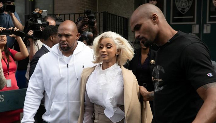 Cardi B surrenders to police after strip-club brawl