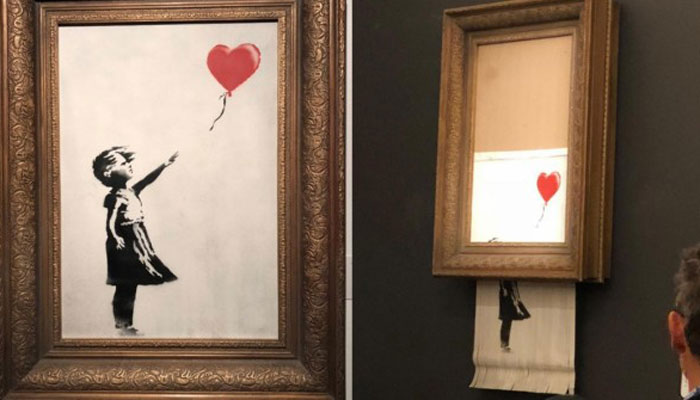 Banksy pranks auction, shreds $1.4 million painting moments after sale