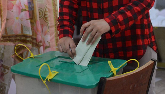 A Pakistani woman casts her ballot during the by-election in Lahore, Pakistan, October 14, 2018. AFP/Arif Ali