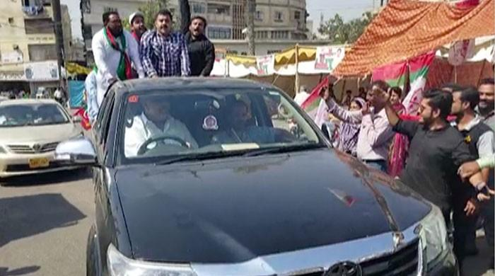 PTI, MQM-P workers face off during Karachi by-election
