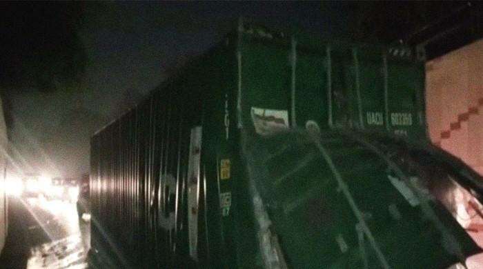 Container full of cosmetics gets stuck in Lahore underpass, topples over