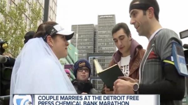 Couple weds halfway through Detroit marathon