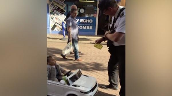 UK traffic warden issues parking ticket to toddler in toy car