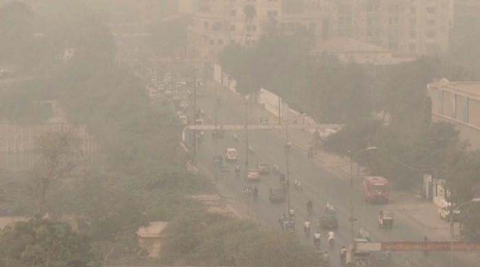 Fog turns to smoke in Karachi as sea breeze halts