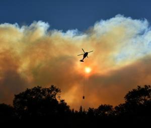 Firefighters battle blazes on two fronts in California, 50 dead