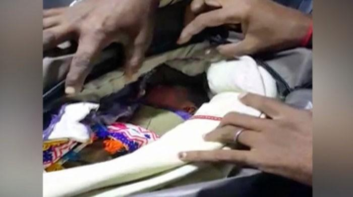 Newborn baby brought in a bag for treatment at Tharparkar hospital