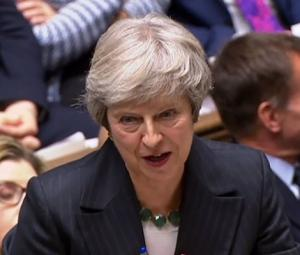 PM May hit by resignations over Brexit draft deal