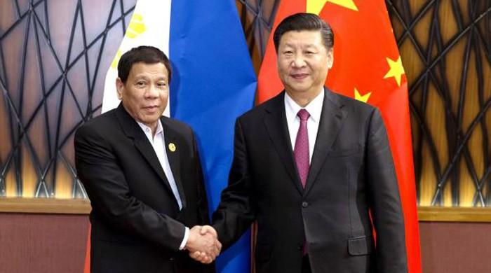 Xi visits Philippines as China, US wrangle for supremacy