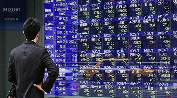 Asian markets see modest gains as US takes a break