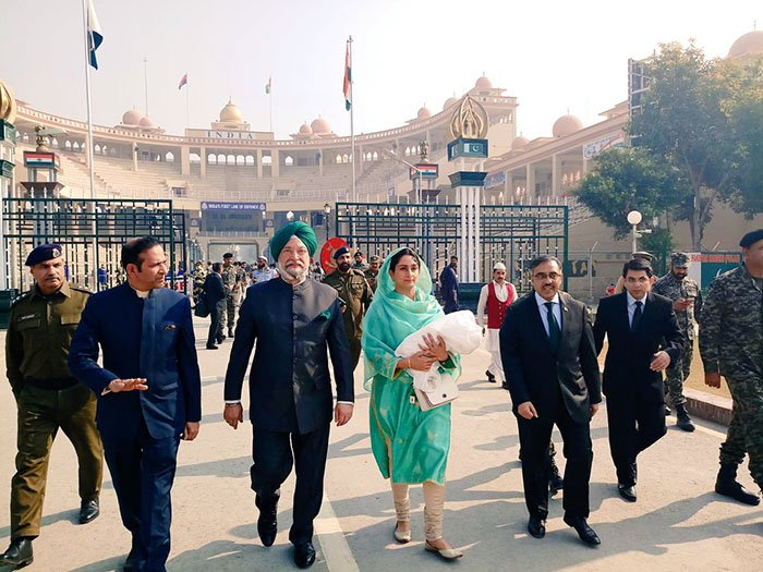 India's Minister for Food Processing and Industries Harsimrat Kaur Badal and Minister of State for Housing and Urban Affairs Hardeep Singh Puri arrive in Pakistan via the Wagah border for the Kartarpur corridor ground breaking. Photo: PTV