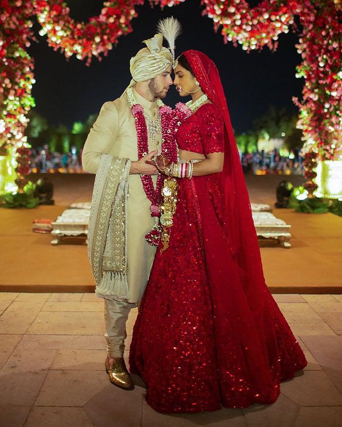 Nick Jonas and Priyanka Chopra in traditional Indian wedding attire. Photo: People magazine/Priyanka Chopra Twitter
