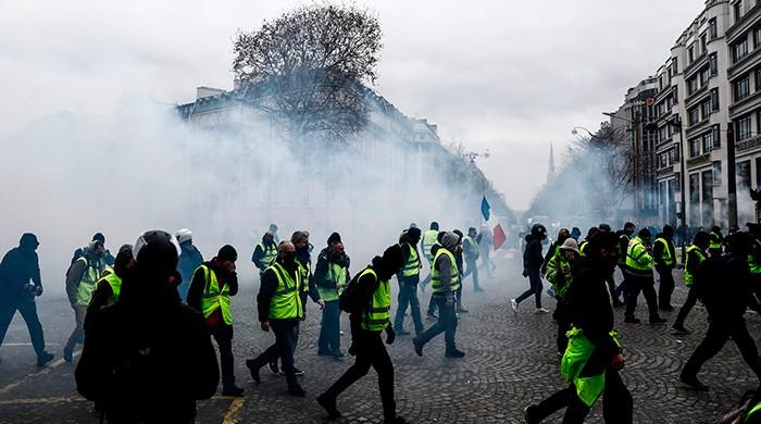 Paris cleans up as Macron prepares response to yellow vests
