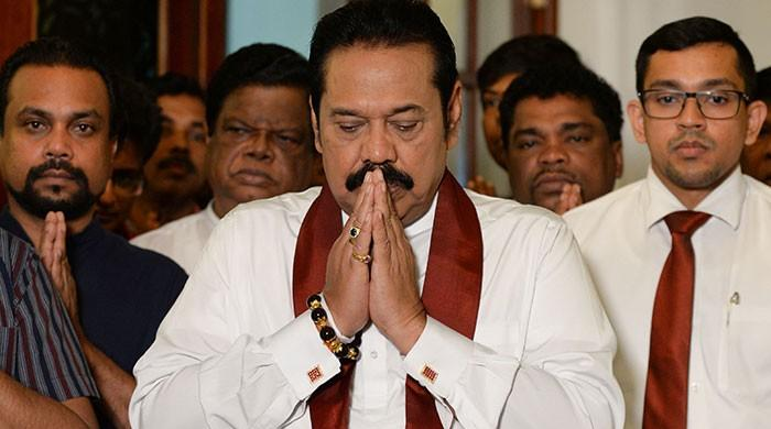 Rajapakse bows out, ending Sri Lanka power struggle
