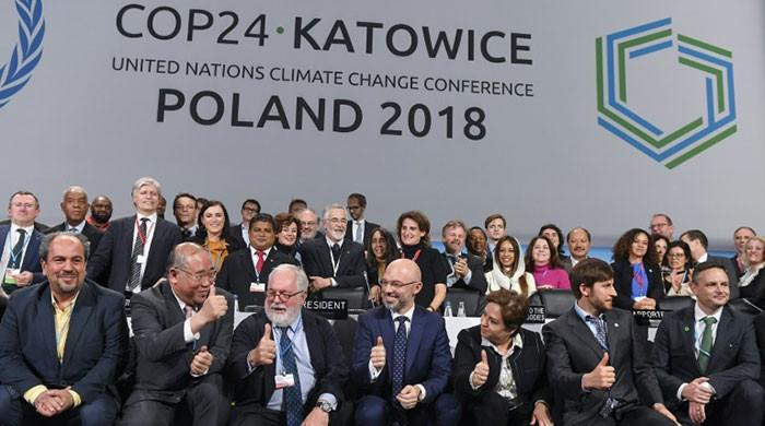 Nations agree milestone rule book for Paris climate treaty