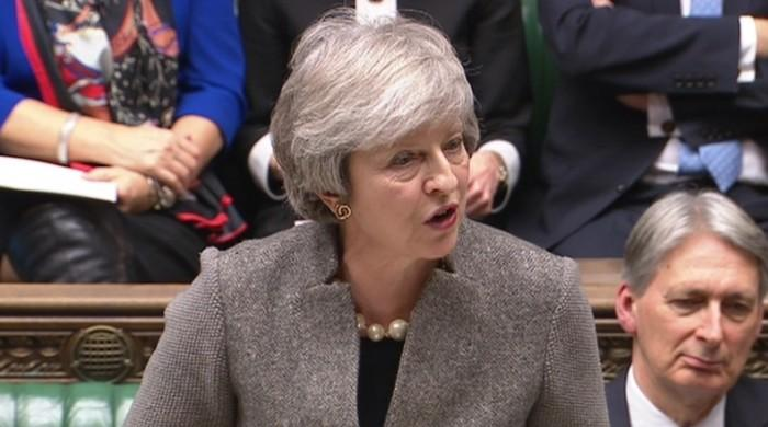 Facing opposition, UK's May will bring Brexit deal back to parliament