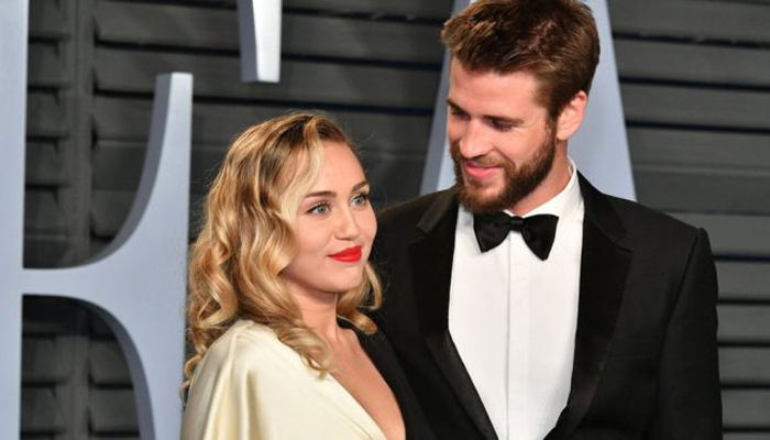 Miley Cyrus appears to confirm marriage to Liam Hemsworth with romantic photos