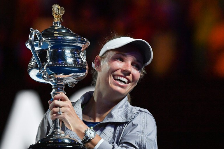 Denmark's Caroline Wozniacki lifts her maiden Grand Slam at Melbourne Park a year ago
