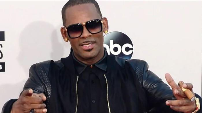 Woman suing R Kelly for sexual abuse says singer threatened her