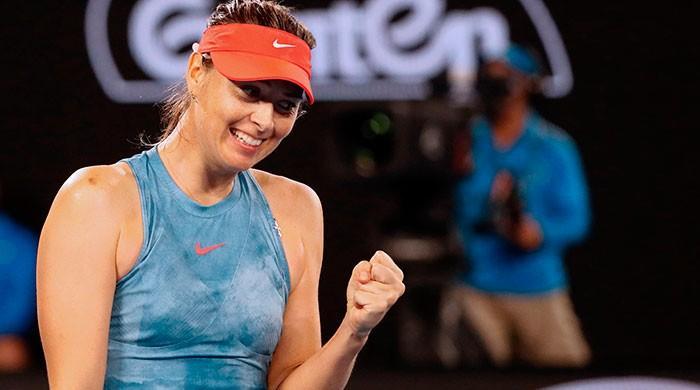 Sharapova stuns Wozniacki as ice man Federer ploughs on