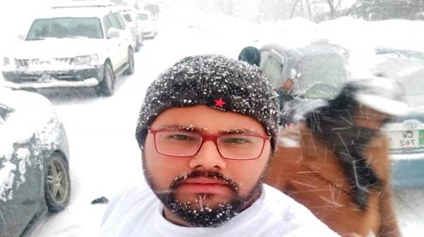 Tourists enjoy snowfall in Lower Dir