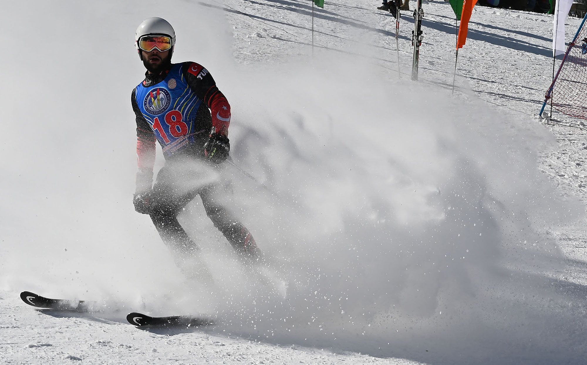 In this picture taken on January 29, 2019, Turkish skier Berkin Usta takes part in the CAS Karakoram International Alpine Ski Cup, at the Pakistan Air Force-owned and operated Naltar Ski Resort, some 25km north of Gilgit in Pakistan´s remote mountainous north. Photo AFP