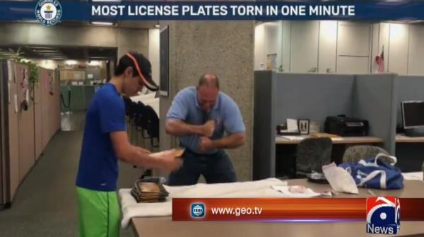 Olympic Strongman tears license plates in half