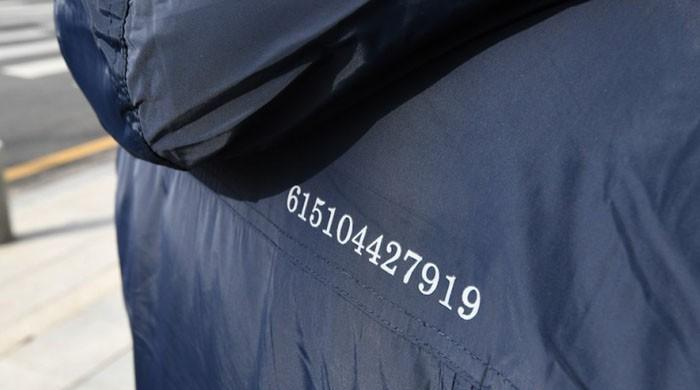 Fashion diplomacy: S Korea officials don coats with message to Kim