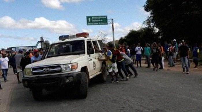 Venezuelan troops kill one in first aid-linked bloodshed