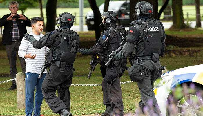 AOS (Armed Offenders Squad) push back members of the public following a shooting at the Masjid Al Noor mosque in Christchurch, New Zealand. PHOTO: REUTERS