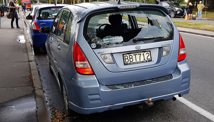A car with shattered windows is parked close to the mosque after a gunman filming himself firing at worshippers inside in Christchurch. PHOTO: AFP