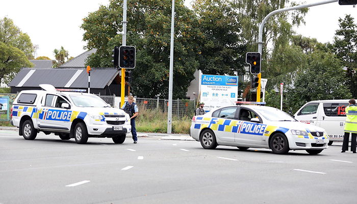This picture released by Radio New Zealand shows police officers cordoning a street near the mosque after a firing incident in Christchurch. PHOTO: AFP