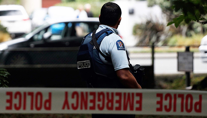 A police officer secures the area in front of the Masjid al Noor mosque after a shooting incident in Christchurch. PHOTO: AFP
