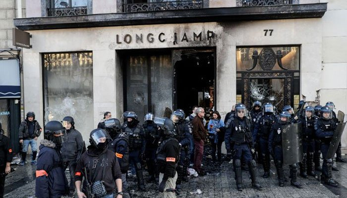 Luxury handbag store Longchamp was among the shops targeted by the rioters on the Champs-Elysees